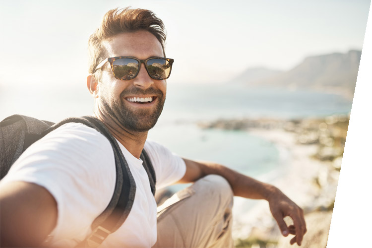 selfie of man in sunglasses at the beach