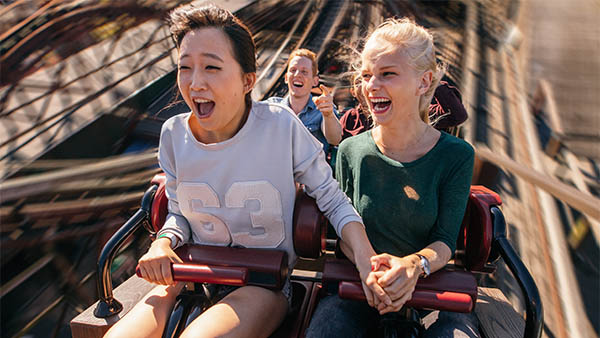 two female friends on a roller coaster
