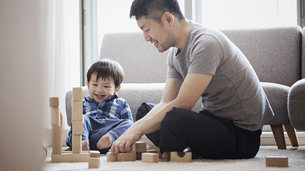 father and son playing with blocks