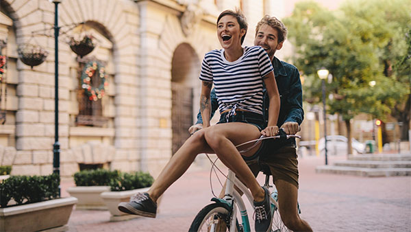 young couple riding a bicycle