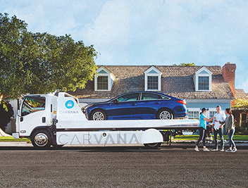Carvana vehicle being delivered