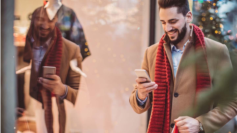 man at the mall looking at phone