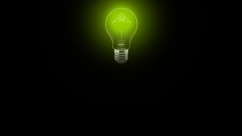 bombilla verde con logo de Regions en el filamento sobre un fondo negro