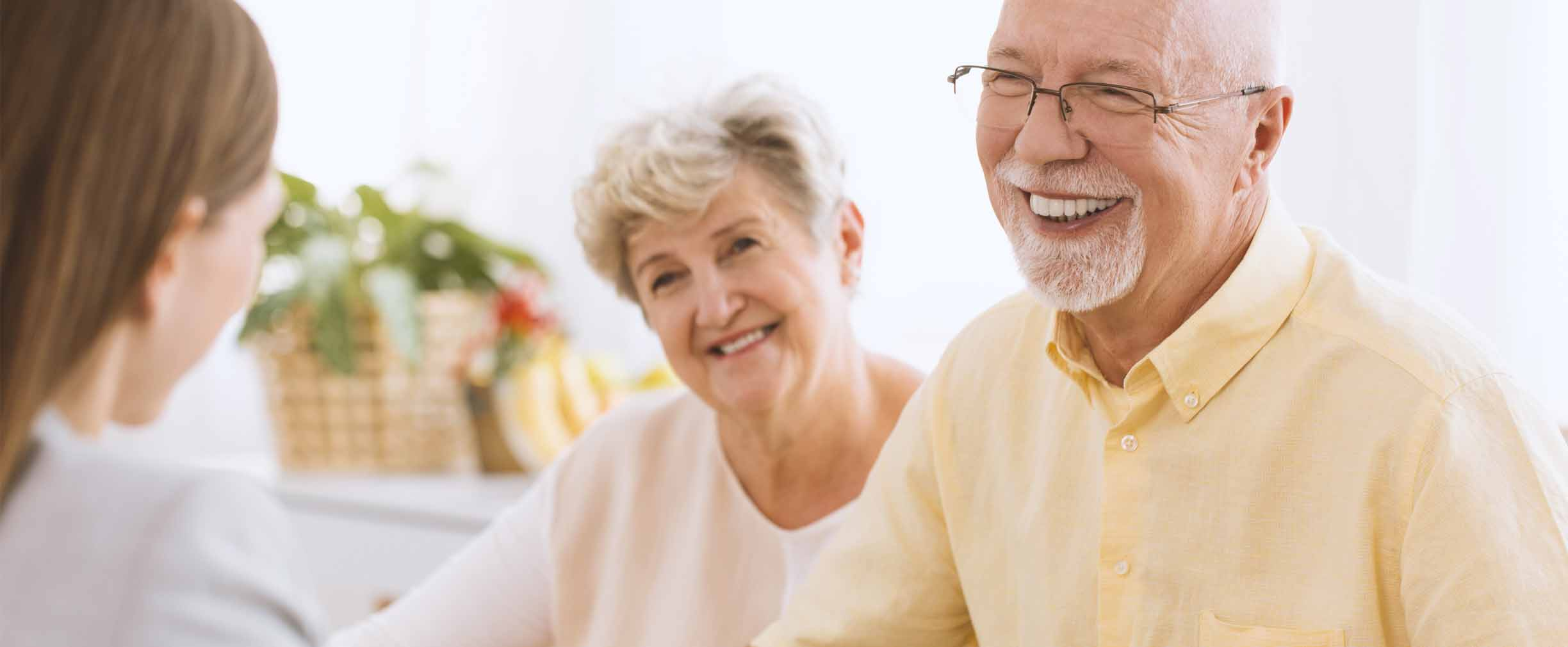 mature couple reviewing estate plan with wealth advisor