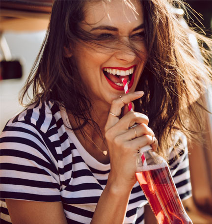 happy woman drinking a soda