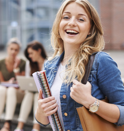 smiling female student holding books