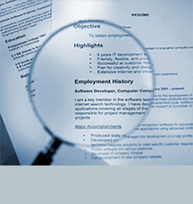 Magnifying glass magnifying employment history on page