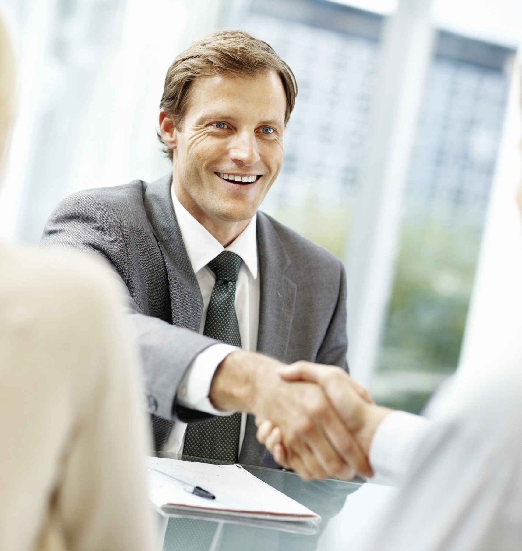 Business officer shaking man's hand