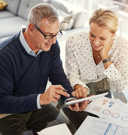 mature couple reviewing their finances on a tablet
