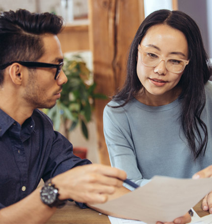 couple reviewing estate plan with advisor