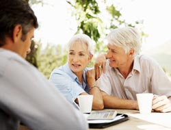 picture of older couple working with financial advisor