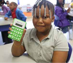 girl holding a green calculator